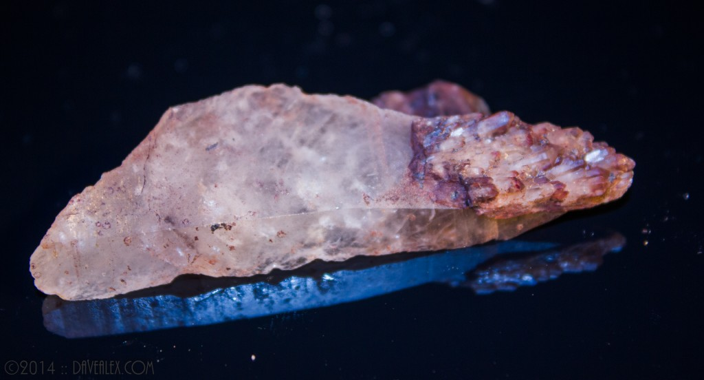 Shard of quartz with parallel growth tip.