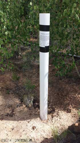 Corner post including paperwork on this federal mining claim