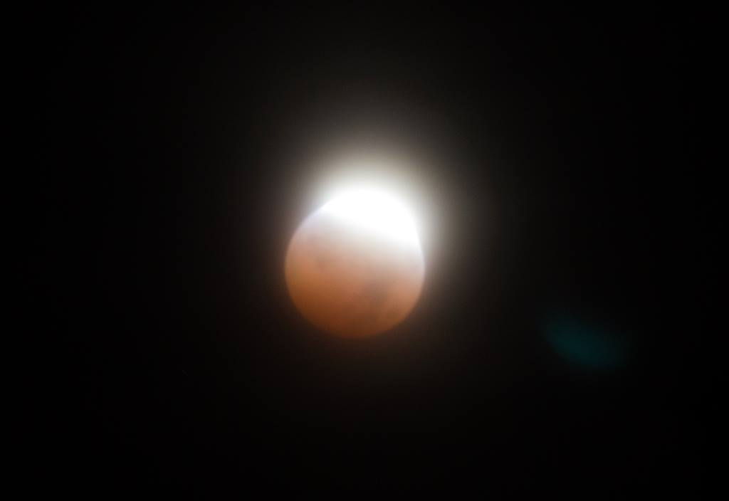 Blood Red moon coming out of total eclipse