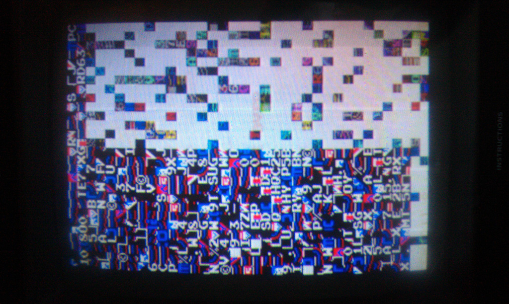 """Here is the Galaga after the replacement CPU.  It was frozen; many of the colors were """"twitching"""" so not completely frozen i guess."""